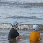 2 Blue capped Boys and sea by jackie martino