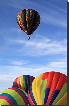 four hot air balloons sky by Jamie Roach