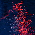 red traffic light on water by Anna Goodchild