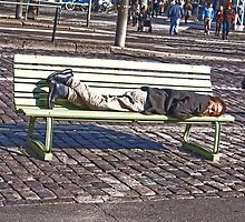 Nobody's perfect.... man on bench down town by Arve Bettum