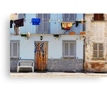 Italian windows with hanging washing and bench Canvas Print