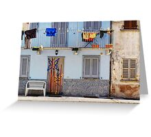 Italian windows with hanging washing and bench Greeting Card