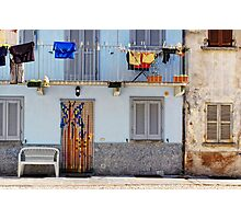Italian windows with hanging washing and bench Photographic Print