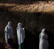 Women praying outside Lalibela church by Euphemia