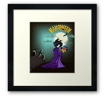 Beautiful witch with pumpkin in Halloween day. Framed Print