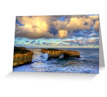 A wave crashes the London Arch at sunrise Greeting Card