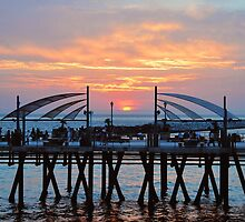 Sunset Horseshoe Pier  by Walt Conklin