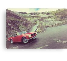 Retro car driving in the mountain Canvas Print