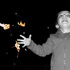 tossing leaves in the dark by tego53