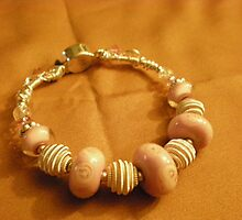 Pink and silver hand wire wrapped bracelet by Sherry Laird