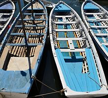 Blue and white wooden boats by louizaa