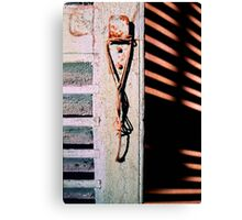 Hanging rope, old shutter and shadows Canvas Print