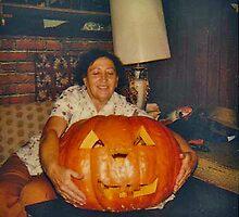 Vickie with a Big Max Pumpkin she raised herself. by Edward Henzi