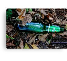 Bottle of beer with in the leaves. ( man made and Nature series) Canvas Print