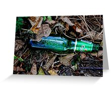 Bottle of beer with in the leaves. ( man made and Nature series) Greeting Card