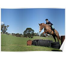 Horse and rider jumping Poster