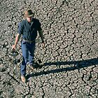Farmer enduring drought, far west NSW by Brian McInerney
