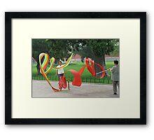 Ribbon Twirlers Framed Print