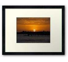 Sunset Over The Water Framed Print