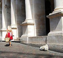 a woman walks her pet by Sanchita  Mukherjee