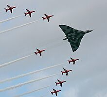 Avro Vulcan Escorted by the Red Arrows by Tony Steel