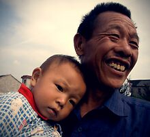 Chinese grandfather, grandchild, baby, China's People, Rural People of China, China Portraits, Travel in China by eyesoftheeast