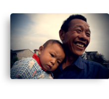 Chinese grandfather, grandchild, baby, China's People, Rural People of China, China Portraits, Travel in China Canvas Print