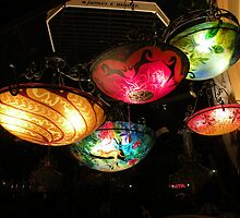 lights in an antique shoppe window by WonderlandGlass
