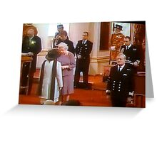 Queen Elizabeth  of England.. presenting the MBE Greeting Card