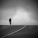 Lonely cyclist by Mitch  McFarlane