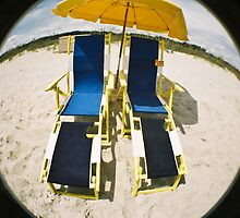 Two empty chairs on the Myrtle beach by Jean Beaudoin