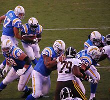 Rivers Hands Off To LT by Ron Hannah