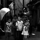 poor young guys and families in slum's alley by momarch