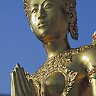 Golden Statue Outside Temple of Emerald Buddha in Bangkok, Thailand  by Petr Svarc