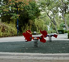 Deserted Playground And Bench At Dusk by Michael Redbourn