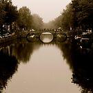 Misty Amsterdam Bridge by Rommel Andrew Henricus
