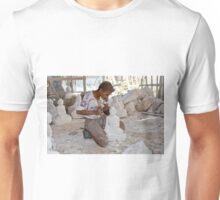 a boy chisels in workshop of Buddha Statues Unisex T-Shirt