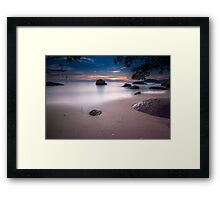 View of the beach and rocks during sunset. Framed Print