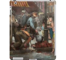City - NY - Drinking water from a street pump 1910 iPad Case/Skin