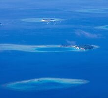 North Ari Atolls in Maldives - aerial view over Eden on Earth by Digital Editor .