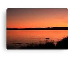 Boat ride at sunset Canvas Print