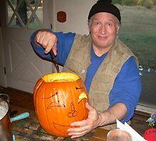 Mom's spirit guides Dennis as he carves JackOLantern. by Edward Henzi