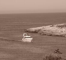 Yacht coming into harbour - Cala Egos, Majorca by sarahwhite404