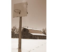 Basketball hoop in front of an old barn Photographic Print