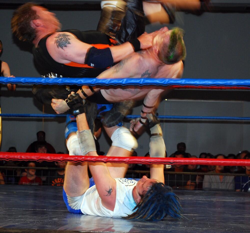 3 way wrestle by Juanita Arnold