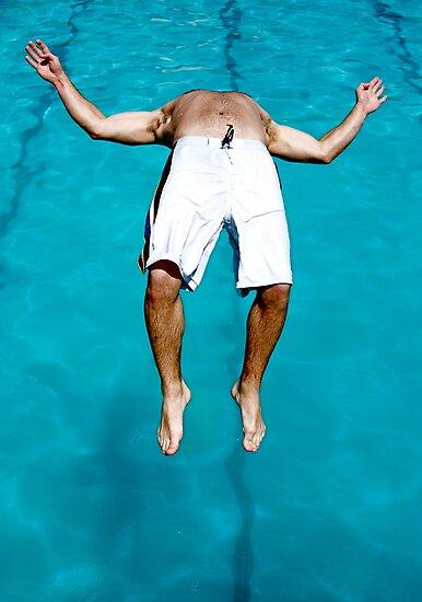 Backflip into a pool by Alastair Humphreys