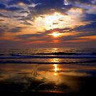 rising sun, beach, skyscape, reflections  by George Salazar