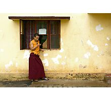 Exiled monk on his mobile phone Photographic Print