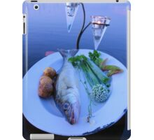 Fresh fish catch on a plate with vegetables iPad Case/Skin