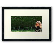 Lucy on seat with hedge  Framed Print